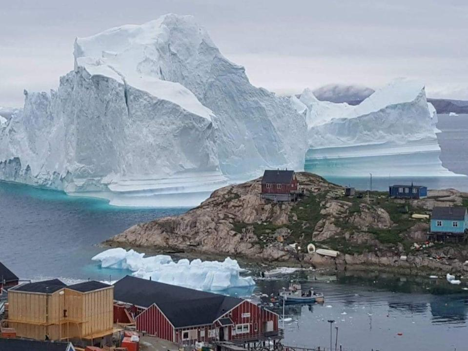 An iceberg grounds  in north-western Greenland. Retreating ice could allow access to billions of gallons of oil (Ritzau Scanpix/AFP via Getty Ima)