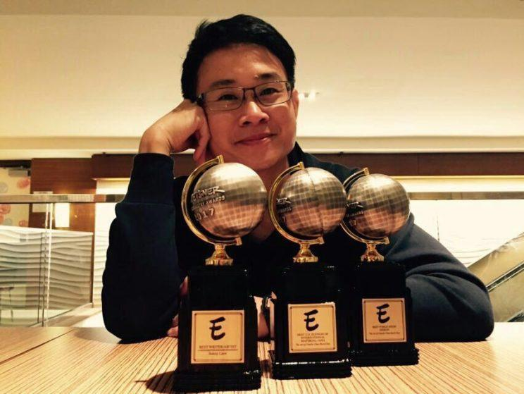 Photo of Sonny Liew with his three Eisner awards: Chan Shiuan