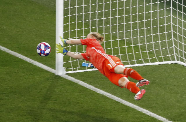 Sweden goalkeeper Hedvig Lindahl dives to stop a penalty shot from Canada's Janine Beckie during the Women's World Cup round of 16 soccer match between Sweden and Canada at the Parc des Princes in Paris, France, Monday, June 24, 2019. (AP Photo/Michel Euler)