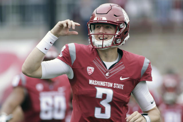 "FILE - In this Sept. 17, 2016, file photo, Washington State quarterback Tyler Hilinski (3) runs onto the field with his teammates before an NCAA college football game against Idaho, in Pullman, Wash. The family of the Washington State University football player who died of suicide in January said the 21-year-old quarterback had extensive brain damage that's been linked to concussions from playing the sport. Tyler Hilinski was found dead in his apartment with a gunshot wound and a suicide note on Jan. 16. Mark and Kym Hilinski told NBC's ""Today"" show on Tuesday, June 26, 2018, that the Mayo Clinic did an autopsy of their son's brain.(AP Photo/Young Kwak, File)"