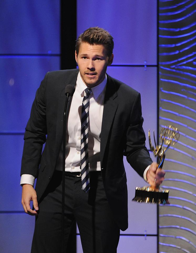 "BEVERLY HILLS, CA - JUNE 16: Actor Scott Clifton accepts the Outstanding Supporting Actor in a Drama Series award for ""The Bold and the Beautiful"" onstage during The 40th Annual Daytime Emmy Awards at The Beverly Hilton Hotel on June 16, 2013 in Beverly Hills, California. (Photo by Kevin Winter/Getty Images)"