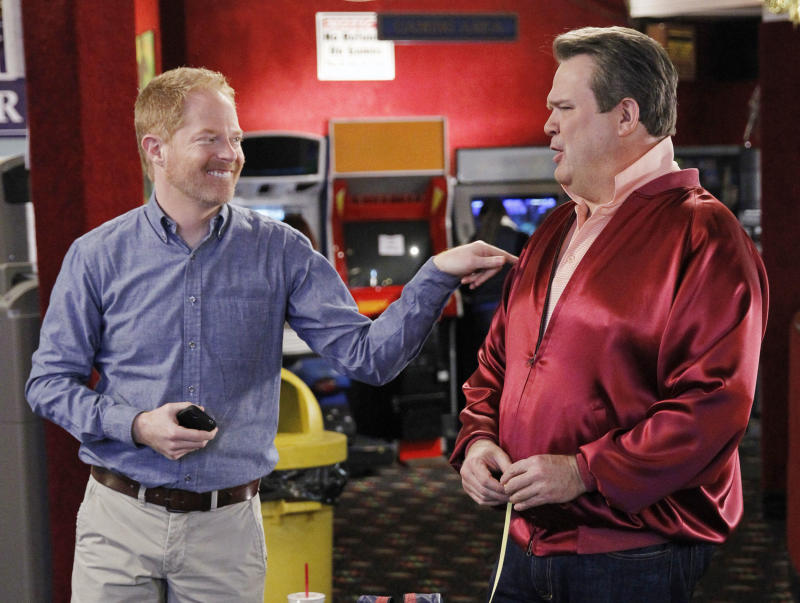 "This TV publicity image released by ABC shows Eric Stonestreet, as Cameron, right, and Jesse Tyler Ferguson as Mitchell in a scene from the comedy ""Modern Family."" Qantas airline is partnering with the show's production company, 20th Century Fox, to fly the cast to Australia next month for a two week shoot of an upcoming vacation episode of the ABC comedy. The comedy, now in its fifth season, has aired previous vacation episodes that were filmed in Hawaii and Wyoming. (AP Photo/ABC, Peter ""Hopper"" Stone)"