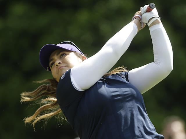 Lizette Salas watches her tee shot on the fifth hole during the final round of the Kingsmill Championship golf tournament at the Kingsmill resort in Williamsburg, Va., Sunday, May 18, 2014. Salas birdied the par-3 hole. (AP Photo/Steve Helber)