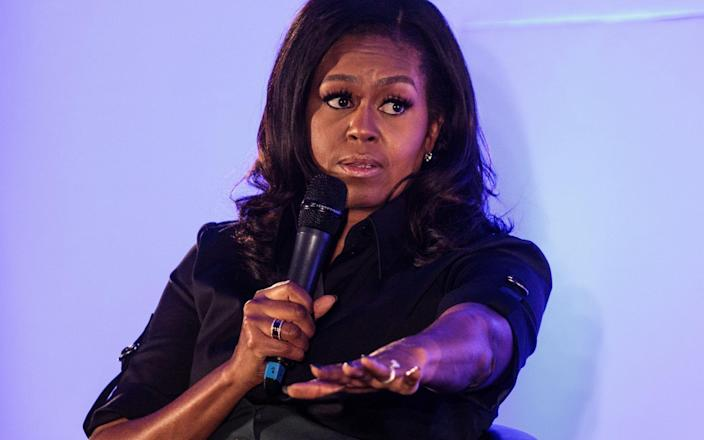 """Mrs Obama said the US is not in a """"post-racial world"""" after his husband Barack's presidency - Getty"""