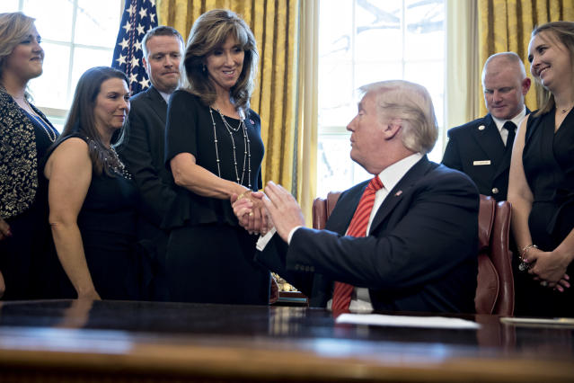Southwest captain Tammie Jo Shults meet President Trump after safely landing Flight 1380 after an engine blew. (Photo: Andrew Harrer-Pool/Getty Images)
