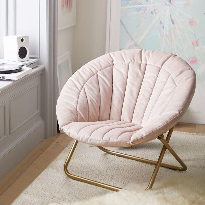 <p>This <span>Velvet Channel Stitch Hang-A-Round Chair</span> ($179) is the perfect room accessory.</p>