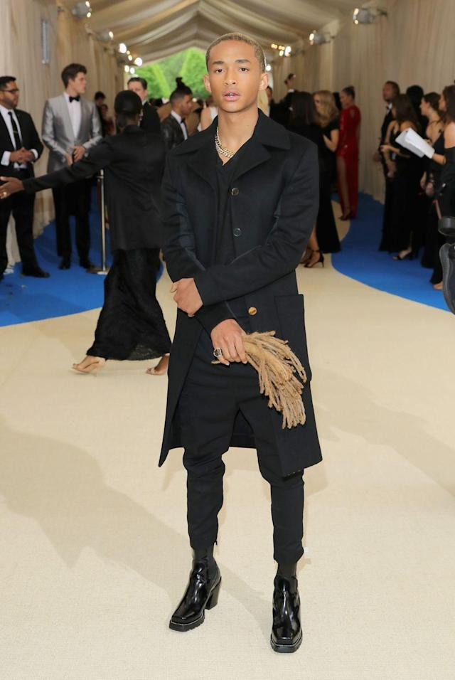 """<p>Smith wore custom Louis Vuitton in a simple, relaxed look. Before the event, he chopped off his hair to wear as an accessory, causing a memorable met moment. """"I couldn't bring my sister as a date, so I brought my hair"""" Smith said. </p>"""