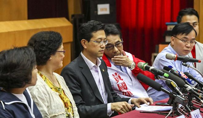 Members of the heavily defeated Federation of Trade Unions hold a press conference. Photo: Nora Tam