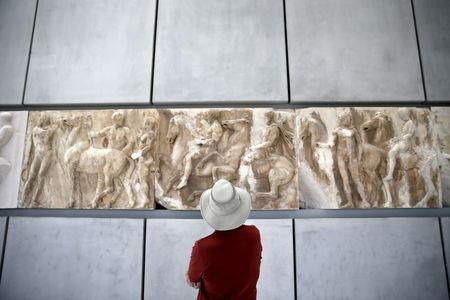 FILE PHOTO: A man looks at exhibits at the Parthenon hall of the Acropolis museum in Athens, Greece, May 18, 2015. REUTERS/Alkis Konstantinidis/File Photo