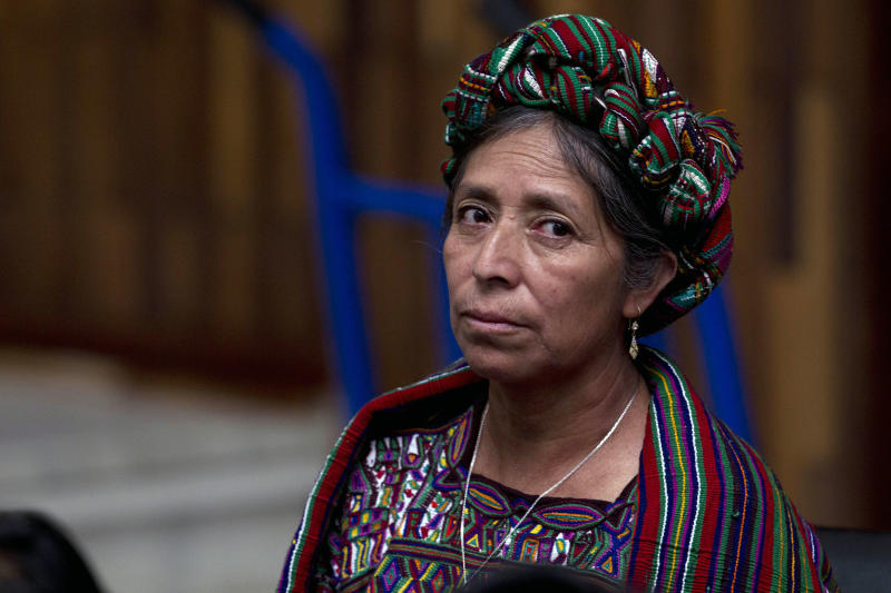 A relative of a victim of the country's civil war attends Guatemala's former dictator Jose Efrain Rios Montt trial on genocide charges in Guatemala City, Tuesday, March 19, 2013. Prosecutors hope to painstakingly prove through a detailed recreation of the military chain of command that Rios Montt must have had knowledge of the massacres of Mayan Indians and others in the Guatemalan highlands during one of the bloodiest phases of the country's long civil war. Because he held absolute power over the U.S.-backed military government, his failure to stop the slaughter is proof of his guilt, prosecutors and lawyers for victims say. (AP Photo/Moises Castillo)