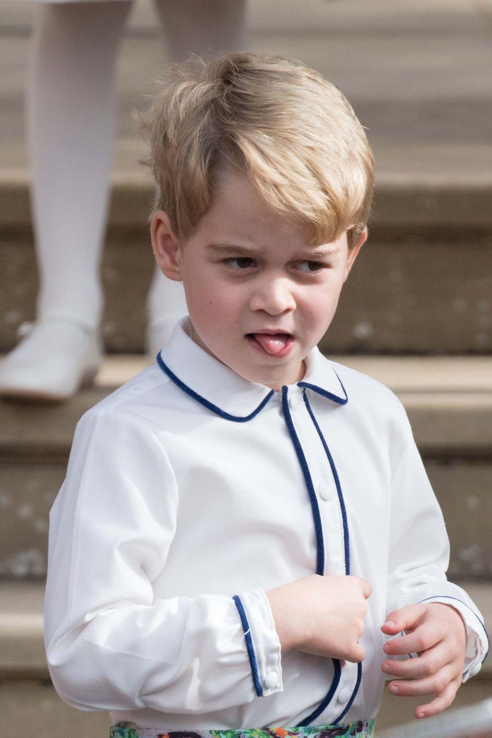 <p>Prince George slyly sticks his tongue out for photographers after the wedding ceremony. </p>