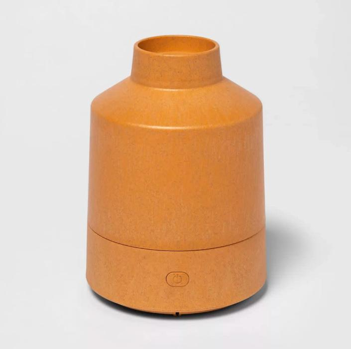 """<strong>Lauren Harbury, small business owner in North Carolina</strong>: Harbury likes to run a diffuser throughout the day and use scents like lemon and peppermint to boost focus.<br><br> We found this trendy terra-cotta inspired diffuser that looks great on your nightstand or desk. Find it for $22 at <a href=""""https://fave.co/341x69m"""" rel=""""nofollow noopener"""" target=""""_blank"""" data-ylk=""""slk:Target"""" class=""""link rapid-noclick-resp"""">Target</a>."""