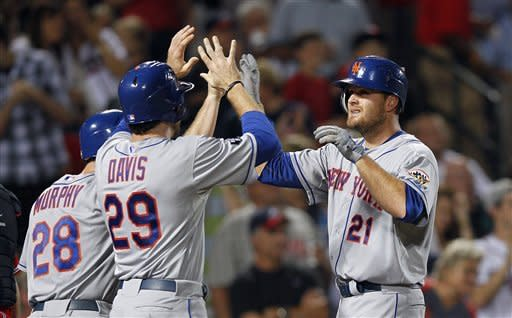 New York Mets right fielder Lucas Duda (21) celebrates with Ike Davis (29) after hitting a three-run home run in the seventh inning of a baseball game against Atlanta Braves in Atlanta, Friday,  Sept. 28, 2012. (AP Photo/John Bazemore)