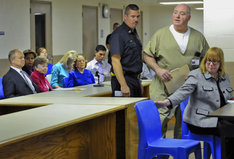 Michael Skakel, second from right, arrives at a parole hearing as family of Martha Moxley, left, look on, at McDougall-Walker Correctional Institution in Suffield, Conn., Wednesday, Oct. 24, 2012. Parole officials denied Skakel's first bid for parole since he was convicted a decade ago of killing his neighbor in 1975. Skakel is serving 20 years to life for fatally beating Martha Moxley with a golf club in Greenwich when they were 15-year-old neighbors. (AP Photo/Jessica Hill, Pool)