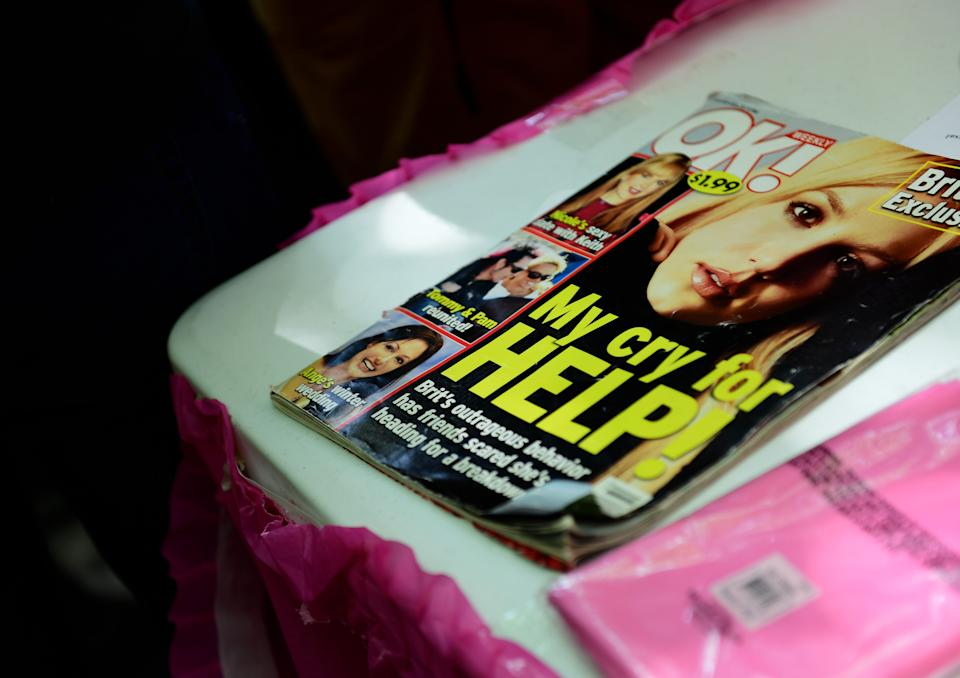 LOS ANGELES, CALIFORNIA - JULY 14: An old magazine is seen on a table at a #FreeBritney Rally at Stanley Mosk Courthouse on July 14, 2021 in Los Angeles, California. The group is calling for an end to the 13-year conservatorship lead by the pop star's father, Jamie Spears and Jodi Montgomery, who have control over her finances and business dealings. Planned co-conservator Bessemer Trust is petitioning the court to resign from its position after Britney Spears spoke out in court about the conservatorship. (Photo by Chelsea Guglielmino/Getty Images)