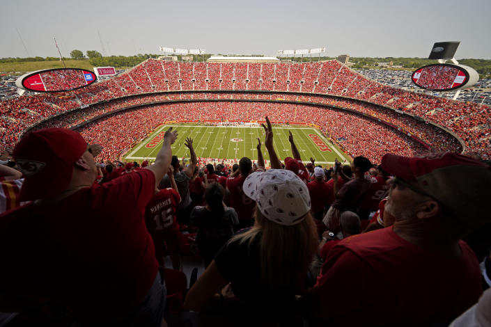 Fans do the tomahawk chop as the Kansas City Chiefs and the Cleveland Browns play during the first half of an NFL football game at Arrowhead Stadium, Sunday, Sept. 12, 2021, in Kansas City, Mo. (AP Photo/Charlie Riedel)