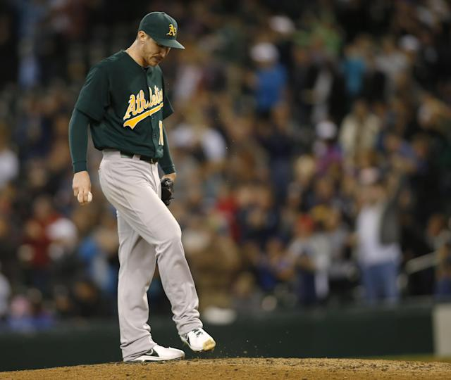 Oakland Athletics starting pitcher Jarrod Parker kicks the mound after giving up a grand slam to Seattle Mariners' Brad Miller during the fifth inning of a baseball game in Seattle, Saturday, Sept. 28, 2013. (AP Photo/John Froschauer)