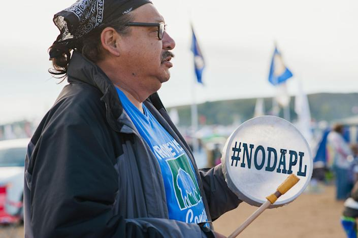 <p>A protester demonstrates against the Dakota Access oil pipeline near the Standing Rock Sioux reservation in Cannon Ball, N.D., on Sept. 9, 2016. (Photo: Andrew Cullen/Reuters) </p>