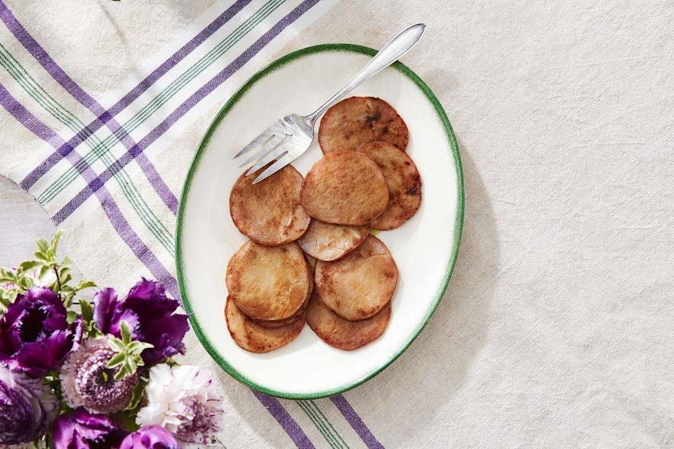 """<p>Simple Canadian bacon gets a wow-worthy upgrade with this two-ingredient glaze.</p><p><strong><a href=""""https://www.countryliving.com/food-drinks/a35684899/honey-mustard-glazed-canadian-bacon-recipe/"""" rel=""""nofollow noopener"""" target=""""_blank"""" data-ylk=""""slk:Get the recipe"""" class=""""link rapid-noclick-resp"""">Get the recipe</a>.</strong></p><p><a class=""""link rapid-noclick-resp"""" href=""""https://www.amazon.com/Victoria-Skillet-Seasoned-Flaxseed-Certified/dp/B01726HD72/?tag=syn-yahoo-20&ascsubtag=%5Bartid%7C10050.g.1681%5Bsrc%7Cyahoo-us"""" rel=""""nofollow noopener"""" target=""""_blank"""" data-ylk=""""slk:SHOP CAST IRON SKILLETS"""">SHOP CAST IRON SKILLETS</a></p>"""