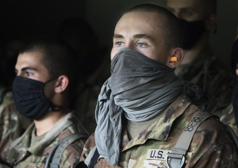 Cadets watch a hand grenade drill, Friday, Aug. 7, 2020, at the U.S. Military Academy in West Point, N.Y. The pandemic is not stopping summer training. Cadets had to wear masks this year for much of the training. (AP Photo/Mark Lennihan)