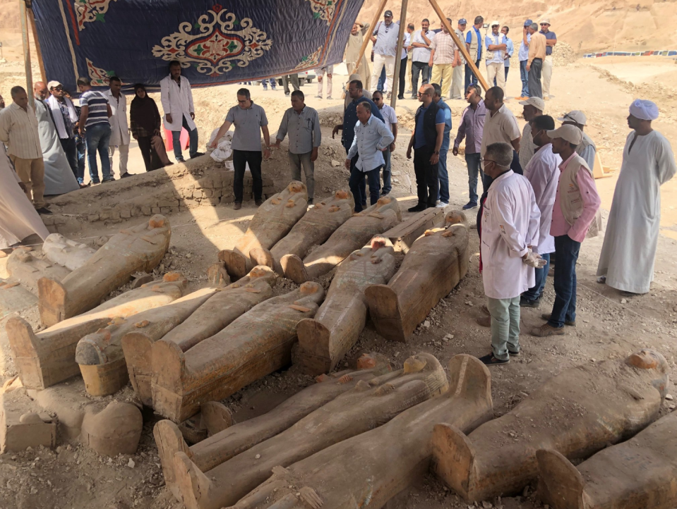 Archaeologists have uncovered at least 20 ancient wooden coffins in the southern Egyptian city of Luxor.