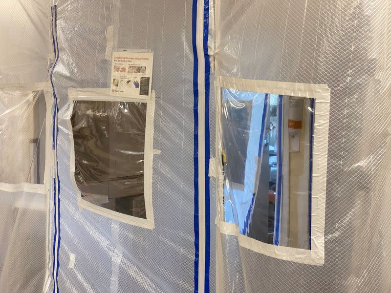 A protective screen is seen at the entrance to a negative pressure ICU hospital room, where COVID-19 patients are treated, at St John's Regional Medical Center in Oxnard