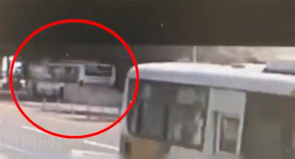 The security footage shows the bus seconds before it is crushed by the falling building. Source: Weibo