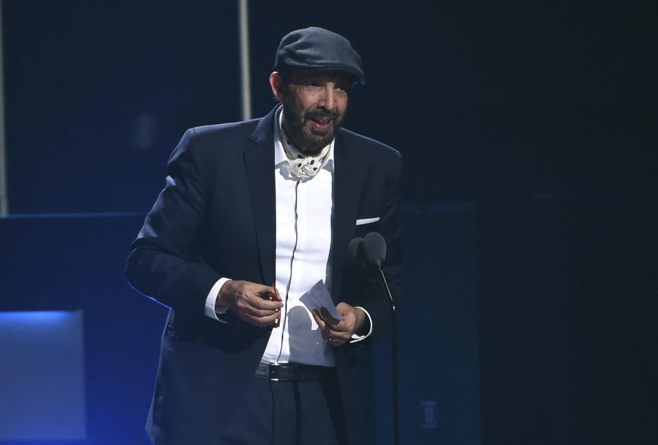 """FILE - Juan Luis Guerra accepts the award for best contemporary/tropical fusion album for """"Literal"""" at the 20th Latin Grammy Awards in Las Vegas on Nov. 14, 2019. Guerra, a 20-time Latin Grammy winner, received six Latin Grammy nominations including record of the year, album of the year and best traditional pop vocal album. (AP Photo/Chris Pizzello, File)"""