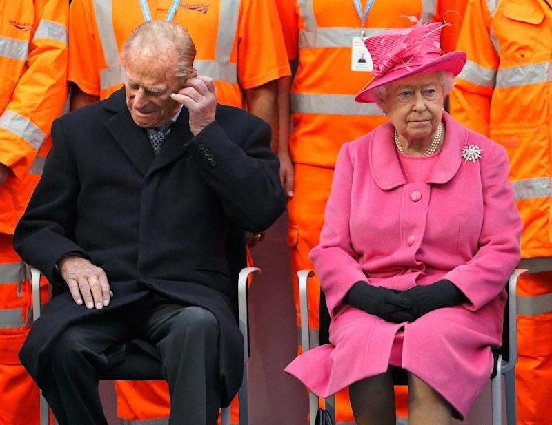 BIRMINGHAM, UNITED KINGDOM - NOVEMBER 19: (EMBARGOED FOR PUBLICATION IN UK NEWSPAPERS UNTIL 48 HOURS AFTER CREATE DATE AND TIME) Prince Philip, Duke of Edinburgh adjusts his hearing aid as he and Queen Elizabeth II visit the newly redeveloped Birmingham New Street Station on November 19, 2015 in Birmingham, England. (Photo by Max Mumby/Indigo/Getty Images)