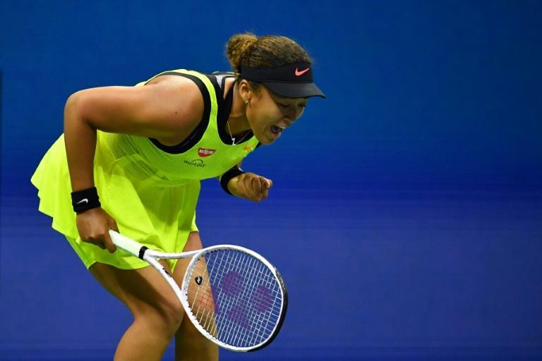 Japanese superstar Naomi Osaka said she'll take a break from tennis after her upset loss to Canada's Leylah Fernandez in the third round of the US Open (AFP/Ed JONES)