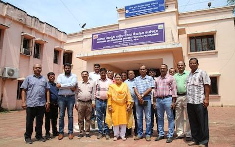 Dr Pramila Baral with her team outside the National Vector Borne Disease Control Programme Centre - Credit: Catherine Davison
