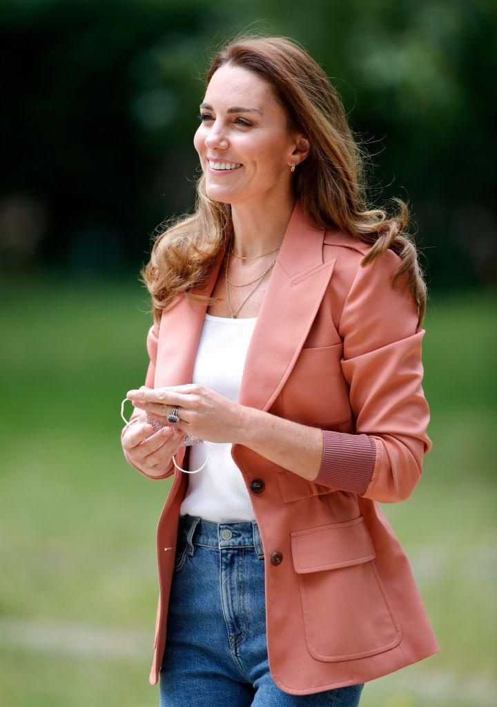 <p>The Duchess of Cambridge made an official appearance at the Natural History Museum in June 2021 wearing a soft coral blazer over a casual white tee and jeans.</p>