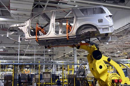 A large robot nicknamed ÒKongÓ lifts the body of a Ford Expedition SUV at Ford's Kentucky Truck Plant as the No. 2 U.S. automaker ramps up production of two large SUV models in Louisville, Kentucky, U.S., February 9, 2018.   REUTERS/Nick Carey