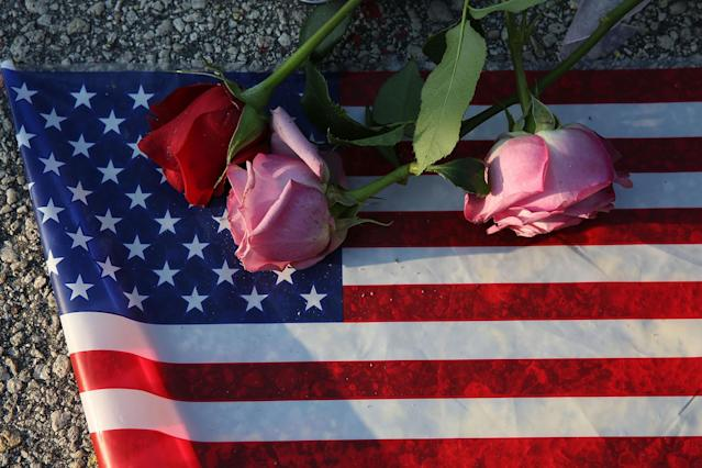 <p>Flowers and an American flag were placed on the ground near the Pulse nightclub, in Orlando, Fla. (Joe Raedle/Getty Images) </p>
