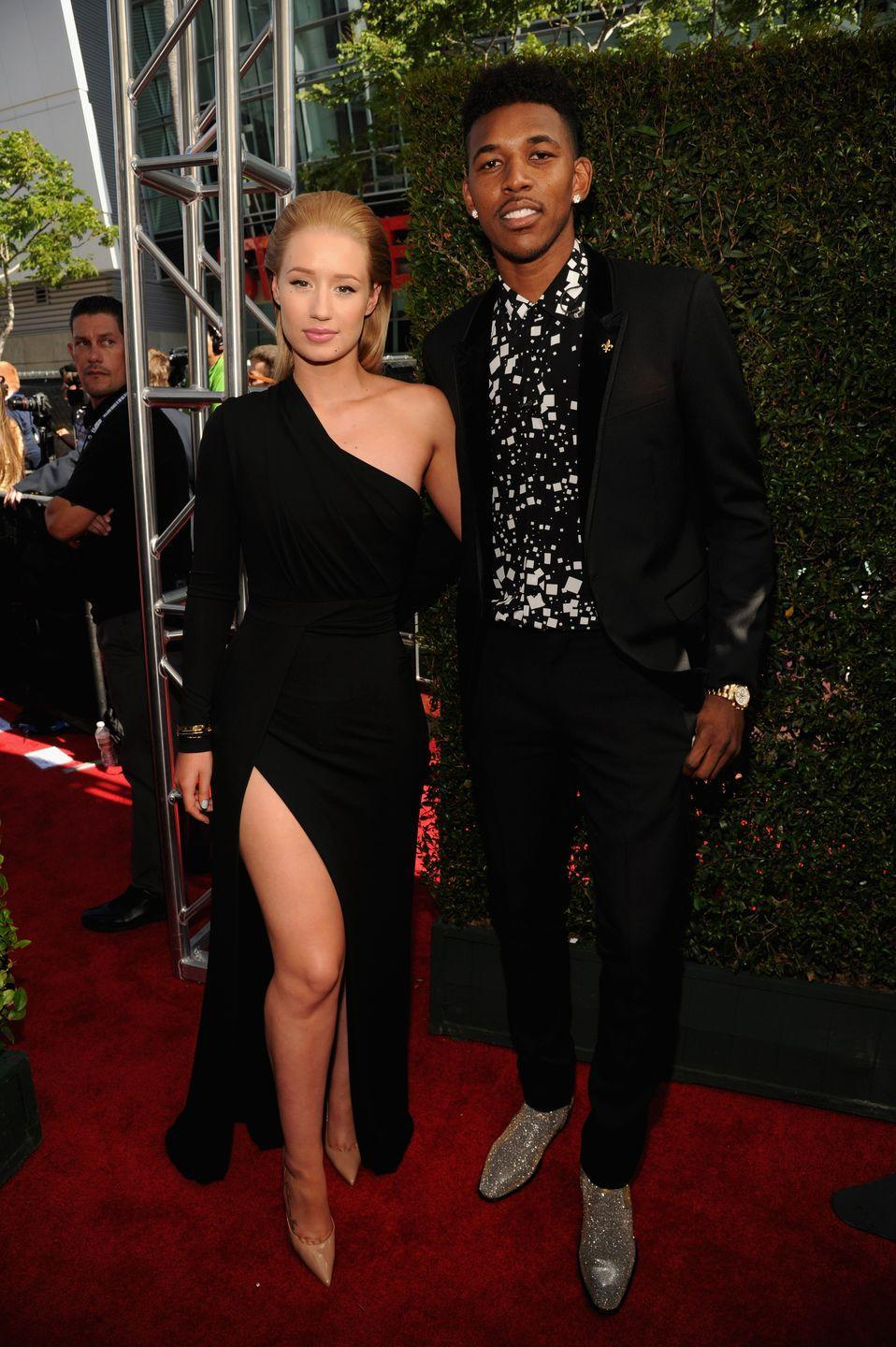 """<p>In 2016, video of the basketball player bragging about cheating on Iggy was leaked by one of Nick's Laker teammates, according to <em><a href=""""https://people.com/celebrity/iggy-azalea-reacts-to-fianc-nick-youngs-alleged-cheating-confession/"""" rel=""""nofollow noopener"""" target=""""_blank"""" data-ylk=""""slk:People"""" class=""""link rapid-noclick-resp"""">People</a></em>. Other than the video, there had been no proof of his infidelity, so Iggy stuck by her fiancé (at first). </p><p>Then, Iggy saw security footage of Nick cheating on her in their home while she was away, reports <em><a href=""""https://people.com/music/iggy-azalea-burned-nick-youngs-clothes-after-split/"""" rel=""""nofollow noopener"""" target=""""_blank"""" data-ylk=""""slk:People"""" class=""""link rapid-noclick-resp"""">People</a></em>. This time, she burned his stuff in a bonfire, and broke off their engagement.</p>"""