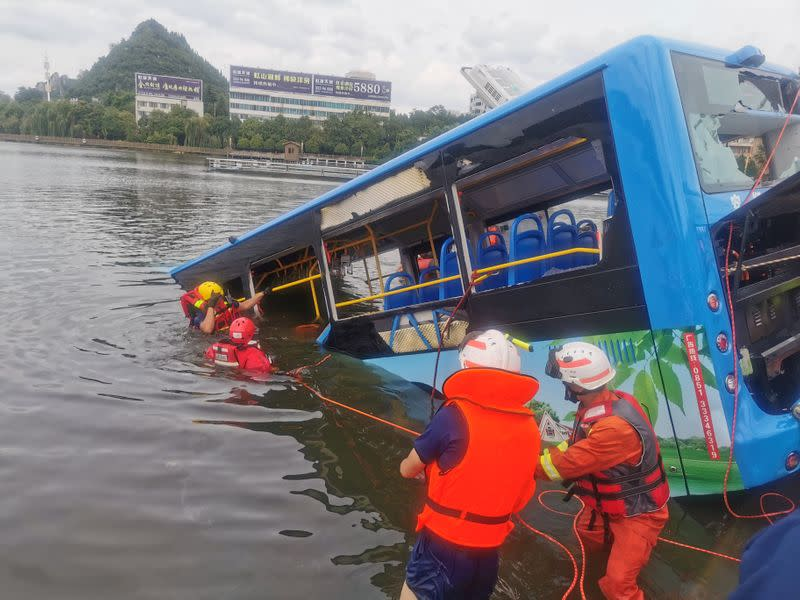 Bus plunges into reservoir in China, 21 dead