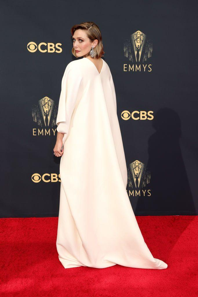 <p>Elizabeth Olsen was a vision in the most simple white sleeved gown. The actress exuded elegance in the pared-back design, which was from her sisters' fashion house, The Row, giving just a hint of sparkle in the form of some dramatic Chopard earrings. </p>