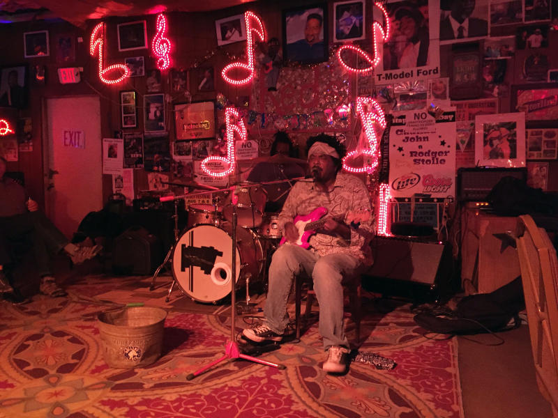 This March 10, 2017 photo shows guitarist Lucious Spiller performing at Red's, one of several clubs in Clarksdale, Miss., hosting live music. Travelers interested in the Delta's region's rich legacy of blues music can also visit museums, historic sites and other attractions. (AP Photo/Beth J. Harpaz)