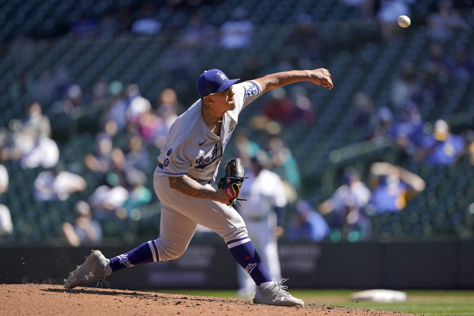 Los Angeles Dodgers starting pitcher Julio Urias throws against the Seattle Mariners in the fourth inning of a baseball game Tuesday, April 20, 2021, in Seattle. (AP Photo/Ted S. Warren)