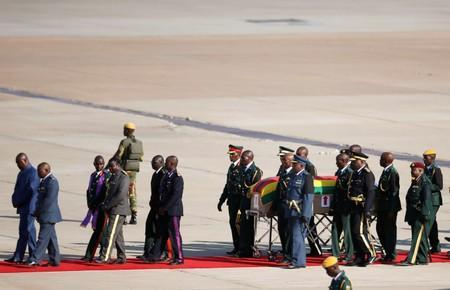 The body of former Zimbabwean President Robert Mugabe arrives back in the country in Harare