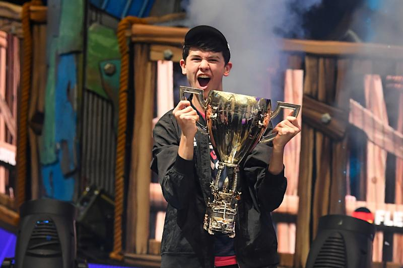 Jul 28, 2019; Flushing, NY, USA; Bugha celebrates his win as the first solo World Champion at the Fortnite World Cup Finals e-sports event at Arthur Ashe Stadium. Mandatory Credit: Dennis Schneidler-USA TODAY Sports TPX IMAGES OF THE DAY