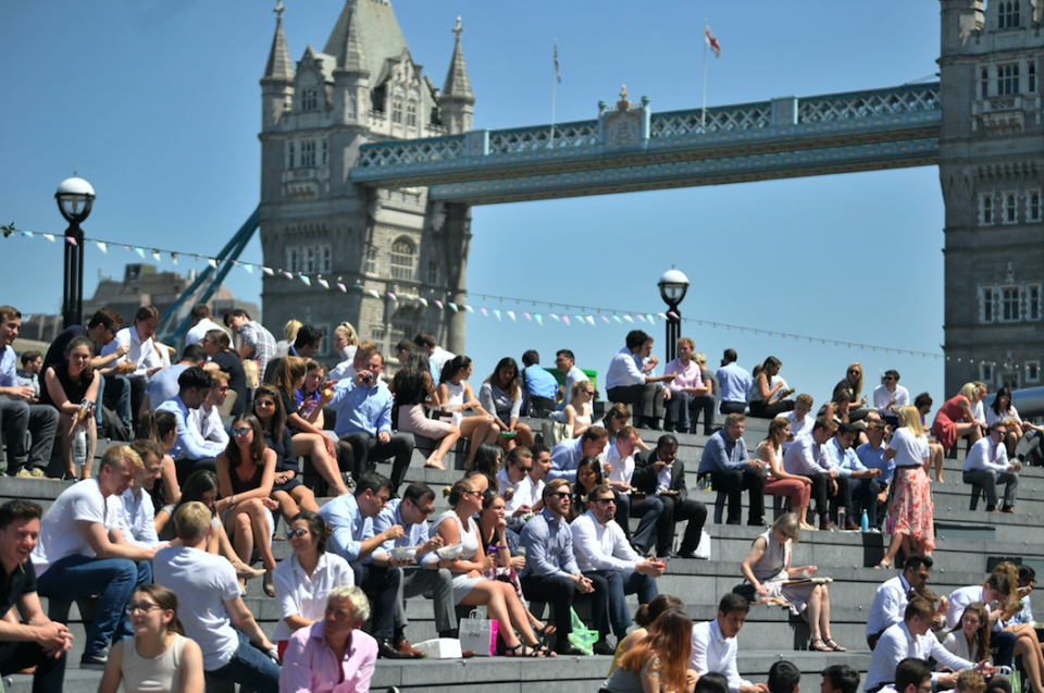 <em>Workers stop for a spot of lunch in the sunshine next to Tower Bridge in London (PA)</em>