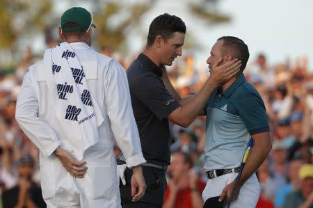Justin Rose of England congratulates Sergio Garcia of Spain (R) after Garcia won the Masters in a final round playoff during the 2017 Masters golf tournament at Augusta National Golf Club in Augusta, Georgia, U.S., April 9, 2017. REUTERS/Jonathan Ernst