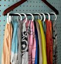 """<p>Instead of draping them across whatever's in your path (the back of a chair, a door knob, your bed post), corral scarves neatly together on just a single hanger. This also works perfectly for other accessories, like belts and handbags. </p><p><a href=""""http://hip2save.com/2014/03/18/5-ways-to-organize-scarves/"""" rel=""""nofollow noopener"""" target=""""_blank"""" data-ylk=""""slk:See more at Hip 2 Save »"""" class=""""link rapid-noclick-resp""""><em>See more at Hip 2 Save »</em></a></p>"""