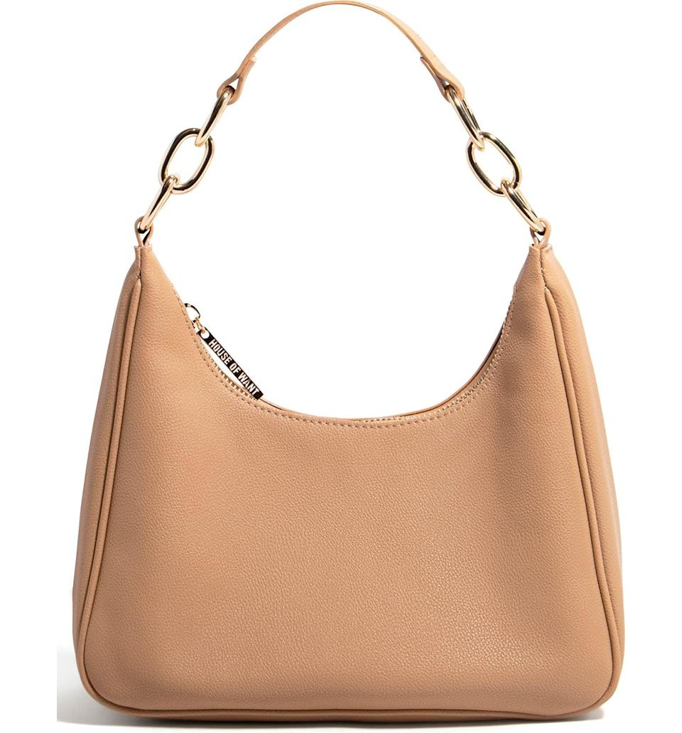 <p>This <span>House of Want Newbie Vegan Leather Shoulder Bag</span> ($98) is a trendy on-the-go bag that has just enough room for all your small items. It looks sleek and polished, and it's designed in vegan leather so you can feel good about your purchase.</p>