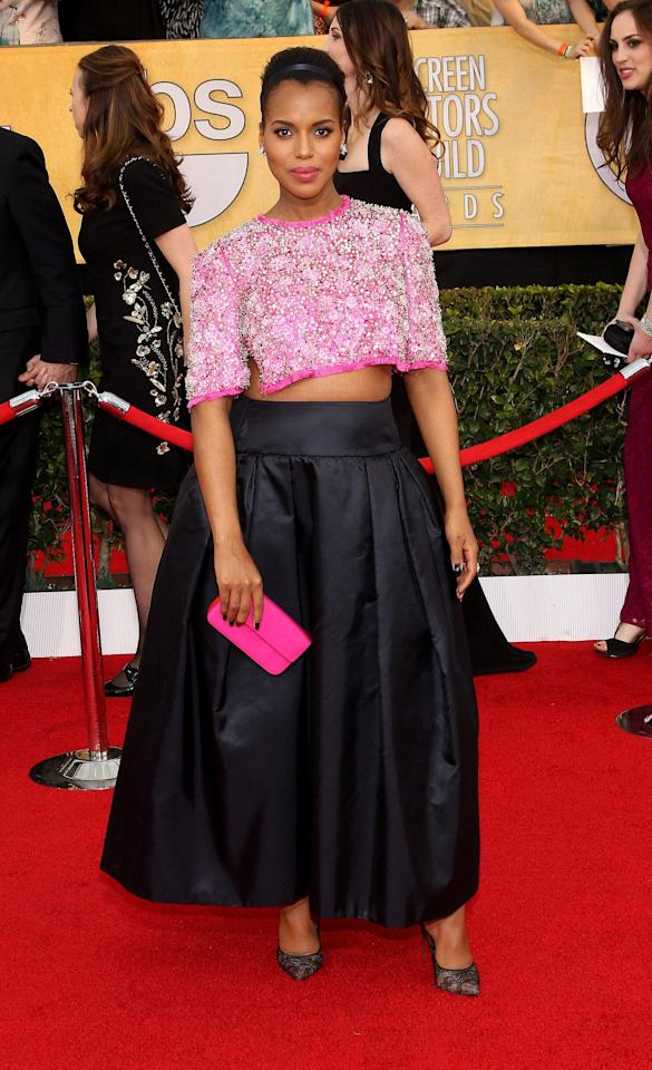 "<p>At the 2014 SAG Awards, Kerry Washington gave the public a small glimpse of her budding bump in in a Prada pink patterned crop top and long black billowy skirt. She was six months pregnant and <a rel=""nofollow"" href=""http://celebritybabies.people.com/2014/01/18/sag-awards-kerry-washington-pregnant-crop-top/"">told</a> <em>People </em>that she didn't have anything to hide, so she wanted to have a little fun with her outfit. <em>(Photo: Getty)</em> </p>"