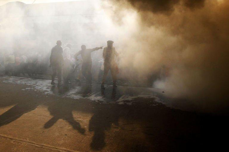 Bangladeshi firefighters attempt to extinguish a burning train compartment at Dhaka's Kamalapur Railway Station during a nationwide strike called by Jamaat-e-Islami on March 4, 2013