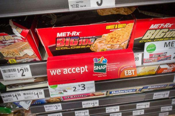 PHOTO: A sign on a sales rack of an energy bar in a 7-Eleven in New York on July 27, 2014 promotes the convenience store's acceptance of the SNAP (Supplemental Nutrition Assistance Program) formerly known as EBT. (Richard B. Levine)
