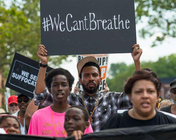 PHOTO: Rally participants hold signs while marching in Staten Island, N.Y., on the second anniversary of the death of Eric Garner, July 17, 2017. (Albin Lohr-Jones/LightRocket via Getty Images, FILE)