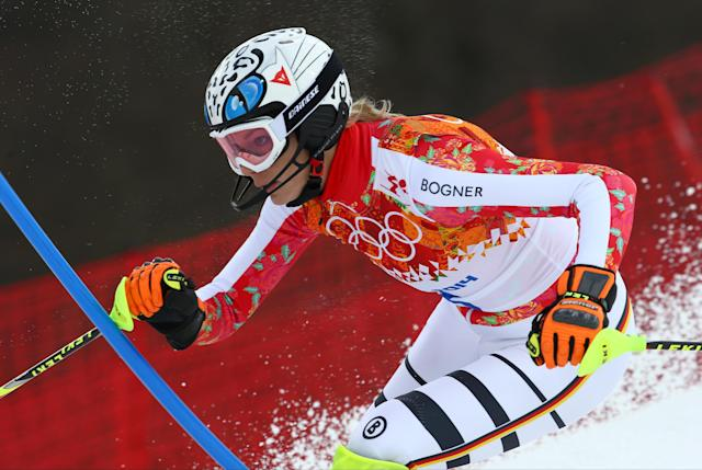 Germany's Maria Hoefl-Riesch skis past a gate in the women's slalom during the Sochi 2014 Winter Olympics, Friday, Feb. 21, 2014, in Krasnaya Polyana, Russia. (AP Photo/Alessandro Trovati)